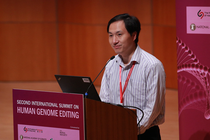Scientist He Jiankui answers questions about his controversial gene-editing experiment Wednesday at the International Human Genome Editing Summit. Photo: VCG