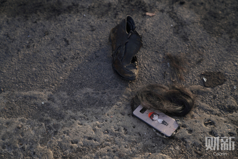 A charred shoe and a clump of hair are pictured near the site of the chemical plant explosion. Photo: Caixin