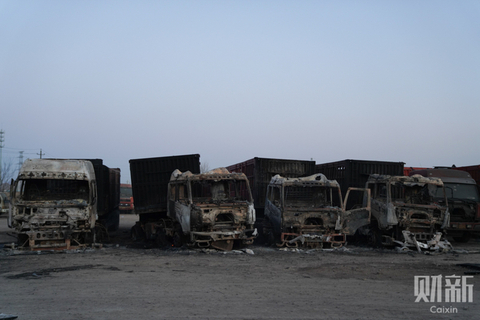 Burnt-out vehicles line the blast site in the Qiaodong district of Zhangjiakou city. Photo: Caixin