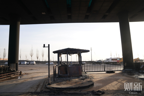 The charred shell of a security guard post at the chemical plant. Photo: Caixin