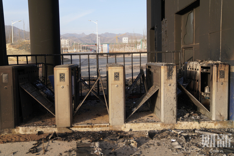 Turnstiles at the entrance of the plant were burned and blackened. Photo: Caixin