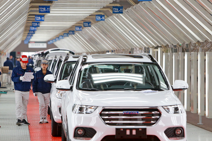 Workers inspect best-selling Haval SUV models on the assembly line in Tianjin in February 2017. Photo: VCG