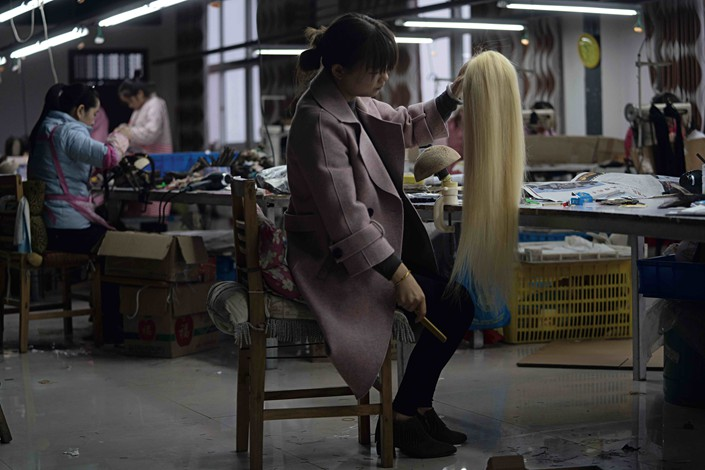 After tens of thousands of crochets, the initial stage of this wig is completed on Nov. 6. After some further changes to its form, dying and some finalising treatments, this wig made from the black hair of a Chinese person will be sent to its buyer in the U.S. Photo: Chen Liang/Caixin