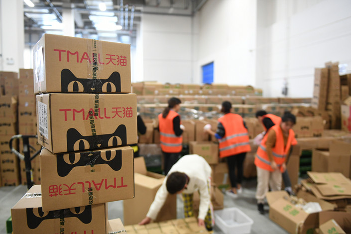 Employees of a Tmall warehouse and logistics base in Hangzhou, Zhejiang province, sort packages on Nov. 11. Photo: VCG