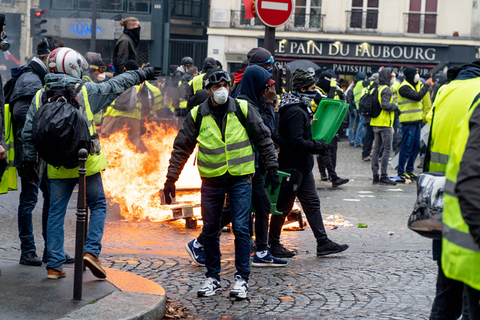 "Demonstrators clash with police Saturday in central Paris. The ""Yellow Vest"" movement initially began in protest of an increase on gasoline taxes proposed by President Emmanuel Macron's administration. However, the protests across France have grown over the past few weeks to represent overall dissatisfaction with the cost of living. Photo: IC"