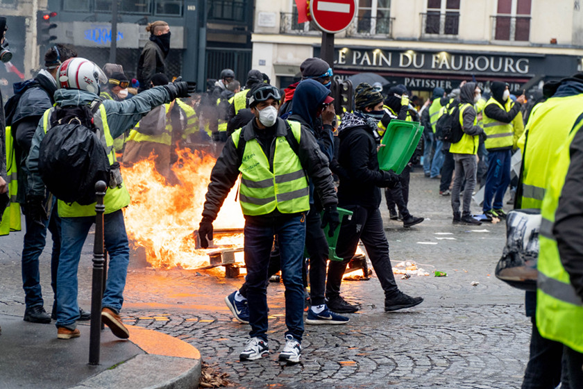 "Demonstrators clash with police Saturday in central Paris. The ""Yellow Vest"" movement initially began in protest of an increase on gasoline taxes proposed by President Emmanuel Macron's administration. However, the protests across France have grown over the past few weeks to represent overall dissatisfaction with the cost of living. Photo: IC_Gallery: France's 'Yellow Vest' Protests"