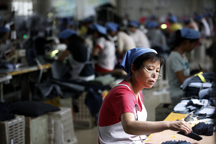 Workers at an export clothing factory in Huaibei, Anhui province, on July 15, 2018. Photo: VCG