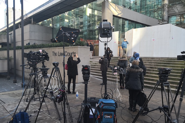 Reporters gather outside the Supreme Court of British Columbia in Vancouver on Friday before the bail hearing for Huawei CFO Meng Wanzhou. Photo: Liu Xiaodong/Caixin