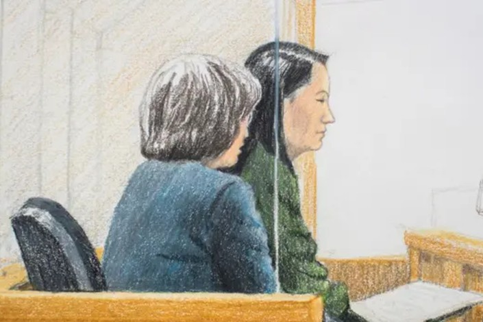In this courtroom sketch, Meng Wanzhou, right, the chief financial officer of Huawei, sits beside a translator during a bail hearing at British Columbia Supreme Court in Vancouver. Photo: Jane Wolsak