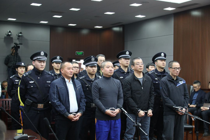 Chen Jihong and other Dezheng Resources staff members are sentenced by Qingdao Intermediate People's Court on Dec. 10. Photo: Qingdao Intermediate People's Court