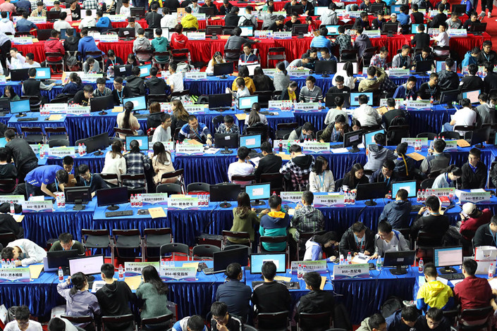 An ACM-ICPC international college students' programming competition takes place at Nanjing University on Oct. 13. Photo: VCG