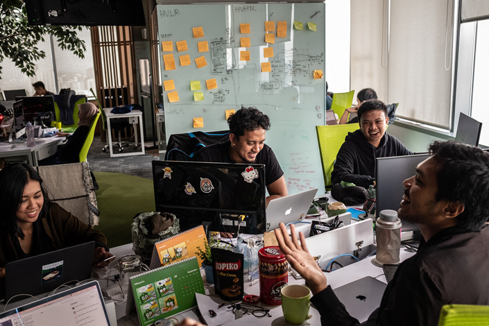 Engineers at PT Tokopedia, Indonesia's largest digital retailer, work in their Jakarta office on Sept. 18. Photo: IC