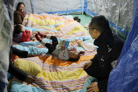 Rescue crews in Yibin, Sichuan province, had set up multiple tents in a temporary resettlement site by Sunday evening, hours after the city's magnitude 5.7 earthquake. Photo: VCG