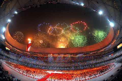 A firework display in Beijing's Bird's Nest Stadium marks the start of the 2008 Summer Olympic Games on Aug. 8 2008, China's first Olympics. Photo: VCG