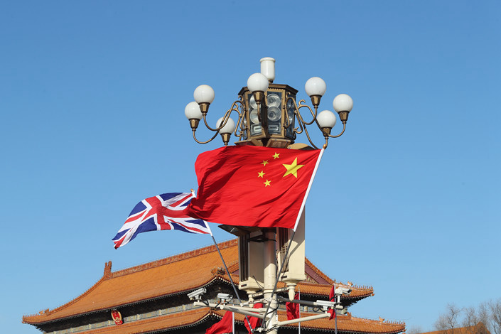 The national flags of the U.K. and China fly on Beijing's Tiananmen Square on Jan. 31. Photo: IC