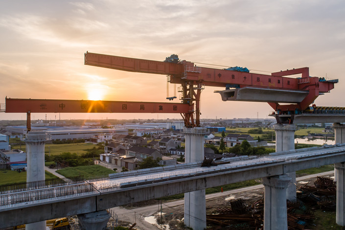 Allowing local governments to issue bonds earlier than usual next year could allow them to invest more in infrastructure, such as this railway under construction on May 8 in the eastern city of Yangzhou. Photo: IC