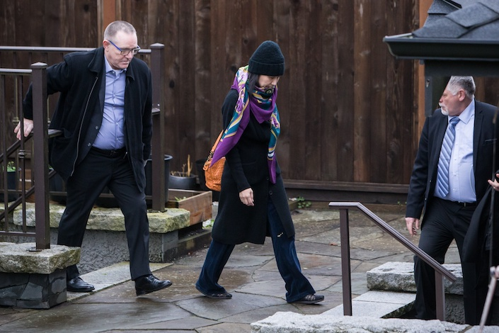Meng Wanzhou leaves her home under the supervision of security on Dec. 12. Photographer: Ben Nelms/Bloomberg