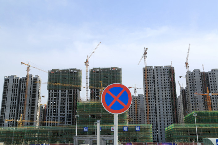 Commercial residential buildings under construction are seen in Heze, Shandong province. Photo: IC
