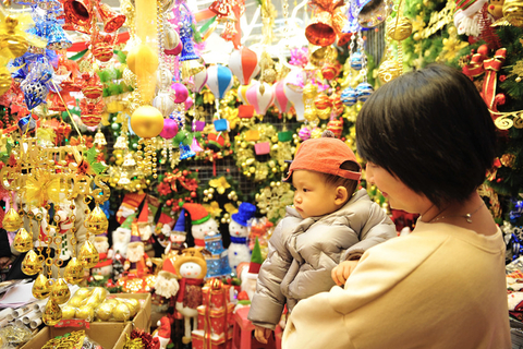 A baby checks out Christmas decorations on sale Monday at the Wu Ai Market in Shenyang, Northeast China's Liaoning province. Photo: IC