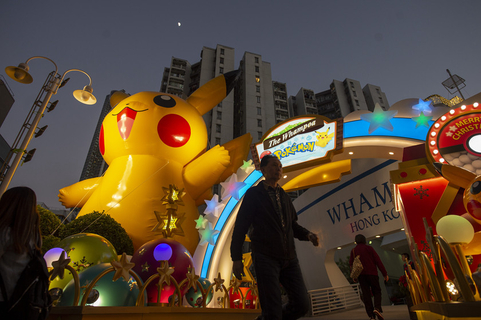 An inflatable character from the Japanese Pokemon franchise towers above an outdoor Christmas display in Hong Kong on Monday. Photo: IC