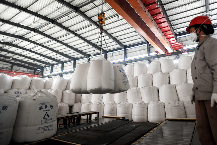 Aluminum oxide powder produced by Aluminum Corp. of China is stored at a warehouse. Photo: VCG