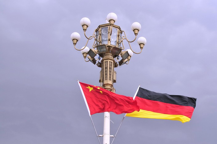 The Chinese and German national flags fly in Beijing. Photo: VCG