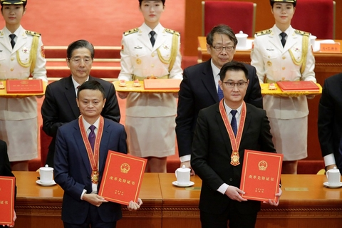 Tech giants personified — Alibaba's Jack Ma and Tencent's Pony Ma— received awards from the state for their contributions in a ceremony marking the 40th anniversary of China's reform and opening-up in Beijing's Great Hall of People on Dec. 18. Baidu's Robin Li also received an award. Photo: VCG