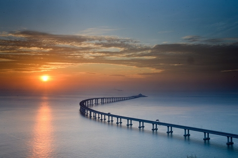 The Hong Kong-Zhuhai-Macau Bridge is seen against the sunset in Hong Kong. The bridge-tunnel system, which is the world's longest cross-sea project, has a total length of 34 miles and opened on Oct. 24. Photo: VCG