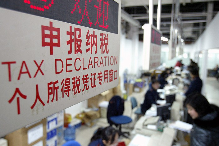 A sign marking where individuals in Shanghai can go to declare income tax. Photo: VCG