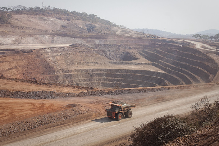 A mining truck drives past an open pit excavation at a copper and cobalt mine in Mutanda, Katanga province, Democratic Republic of Congo, on Aug. 1, 2012. Photo: VCG