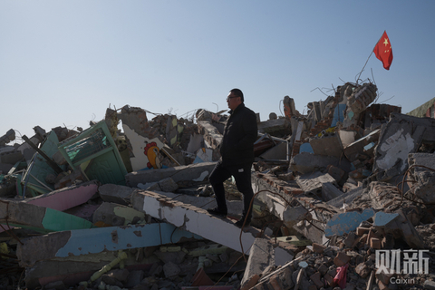 Chen Dadong, the founder of Xiaobaige Kindergarten, stands on the ruins of two three-story school buildings that cost 6 million yuan ($870,000). About 580 students were left without a school to go to after the kindergarten was torn down in Huaiyang county, Zhoukou, Henan province, in February. Dozens of institutions, mostly private kindergartens (preschools) and primary schools, were demolished when local authorities decided to crack down on unlicensed use of land by school operators, though the institutions had education licenses and had been allowed to operate for years. Photo: Chen Liang/Caixin