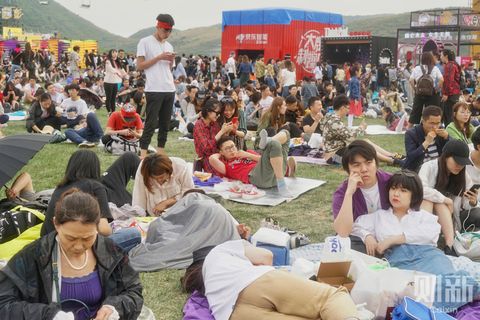 Young people lie on the ground waiting for the opening ceremony of Beijing's Strawberry Music Festival on April 30. The three-day Strawberry Music Festival is one of the biggest music festivals in China, running from April 29 through May 1. Photo: Cai Yingli/Caixin