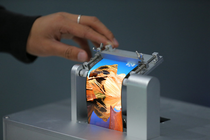 Flexible screens made by BOE Technology Group Co. Ltd. are displayed in October 2017. Photo: VCG