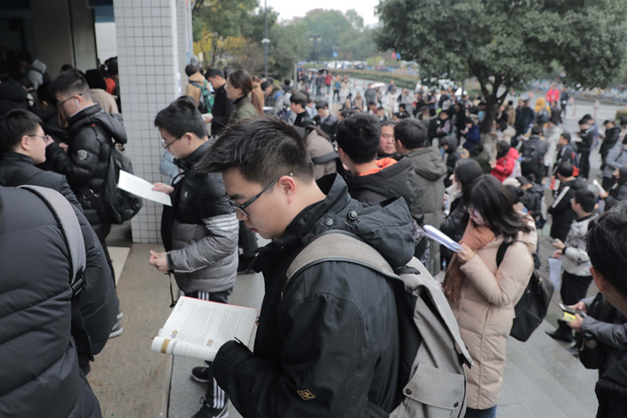 Candidates for the 2019 graduate-school entrance exams wait for the test to begin on Saturday on the campus of Zhejiang University in the eastern city of Hangzhou. Photo: IC
