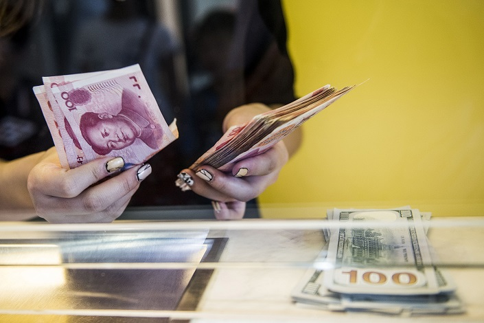 The Chinese currency has had a tough year, pressured by China's slowing economy, trade friction and U.S. interest-rate hikes. Photo: VCG