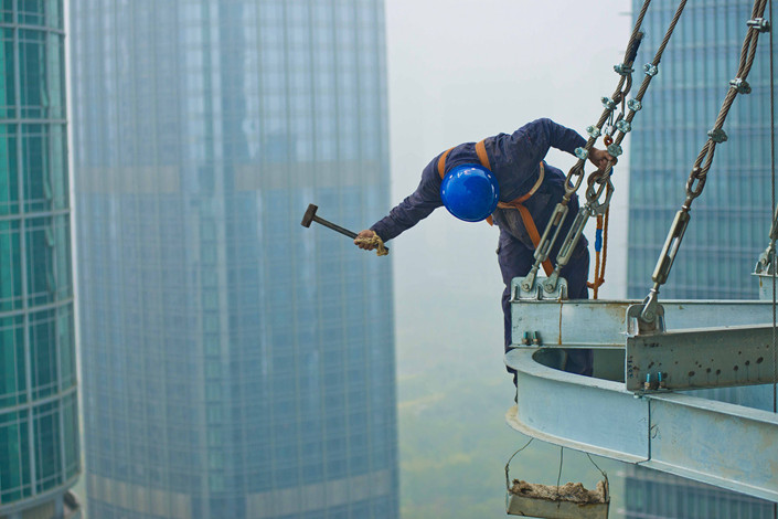 Construction workers are seen in Shenzhen, Guangdong province. Photo: VCG