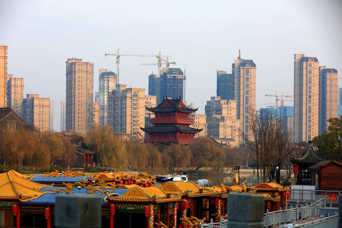 A residential building is seen next to the Dayun River in Huaian, Jiangsu province, on Jan. 1 2019. Photo: VCG