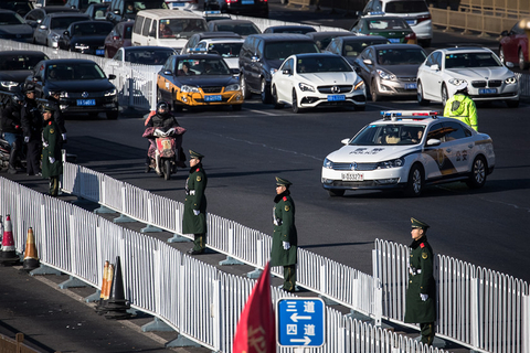 People's Liberation Army soldiers and police officers stand guard in front of Beijing Railway Station before the alleged arrival of North Korean leader Kim Jong Un on Jan. 8. Photo: IC