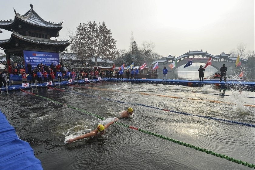 The festival is held on Jan. 10 in a branch of China's Grand Canal, known as the longest and oldest canal in the world. The oldest building along the canal in the area dates back to the Ming Dynasty (1368―1644). Photo: VCG_Gallery: A Chilly Dip in the Grand Canal