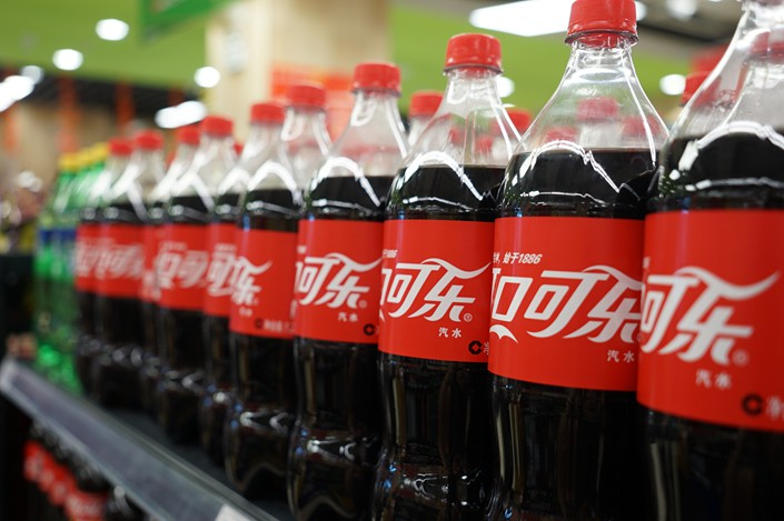 A new report says that Coca-Cola Co. has ingratiated itself with Chinese officials in order to promote a self-serving message: What matters most in preventing obesity is exercise, not diet. Photo: VCG