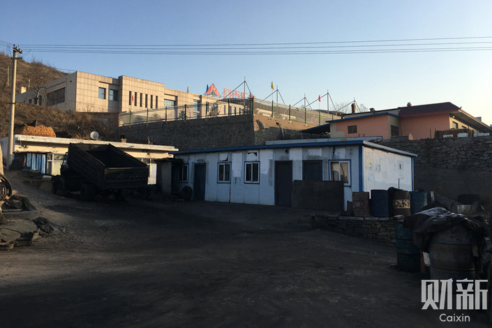 A dormitory for miners is seen in front of Baiji Mining Co. Ltd. in Shenmu, Shaanxi province. Photo: Qin Ziyi/Caixin