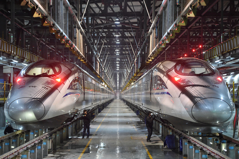 Workers inspect high-speed trains at a maintenance base in Wuhan, Hubei province, on Feb. 1, ahead of last year's Spring Festival. Photo: VCG