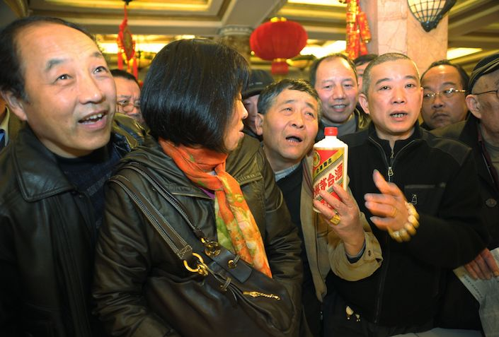 People attend a vintage Moutai liquor auction in Shanghai in 2011. Photo: VCG