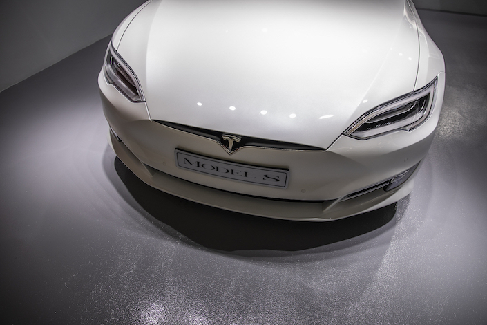 A Tesla Inc. Model S electric vehicle sits on display at a showroom in Hong Kong. Photo: VCG