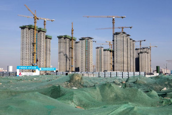 Buildings under construction are seen under a blue sky in Beijing on Jan. 17. Photo: Bloomberg