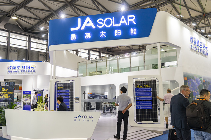 JA Solar's booth at an industry fair in Shanghai on May 30. Photo: VCG