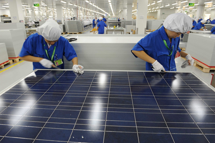 Workers are seen at a solar-panel maker in Hangzhou, Zhejiang province, on Aug. 26. Photo: IC