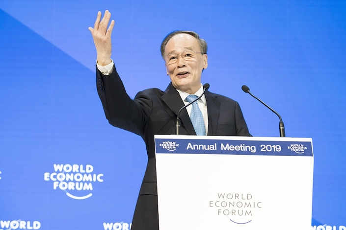 Chinese Vice President Wang Qishan delivers a speech to global leaders at the World Economic Forum in Davos. Photo: VCG