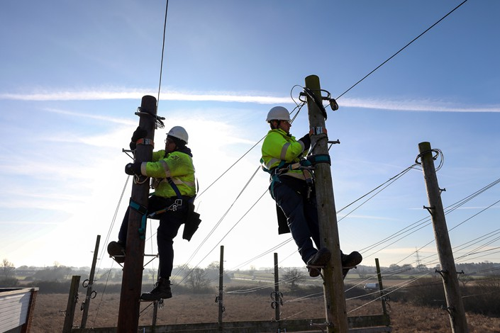 Engineer trainees from BT Openreach, a unit of BT Group PLC, work at the the company's training facility in West Hanningfield, England, in January 2017. Photo: VCG