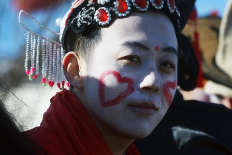 An actor in makeup and traditional costume prepares to play a female role during the Yangsong Town Fair in Beijing's suburban Huairou district on Monday. Photo: IC